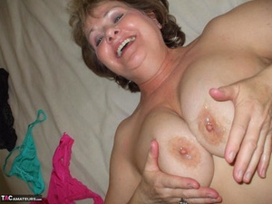 Mature plumper fondles her boobs after removing soaked underwear