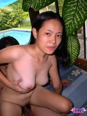 Busty Asian amateur gets spunk on her face after sex on patio with boyfriend