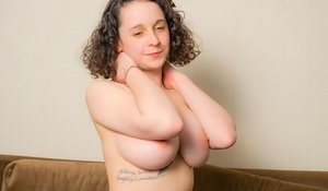 Young solo girl with fair skin unleashes her gigantic inborn tits