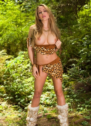 Big titted chick Katie Banks finger fucks outside in jungle cosplay attire