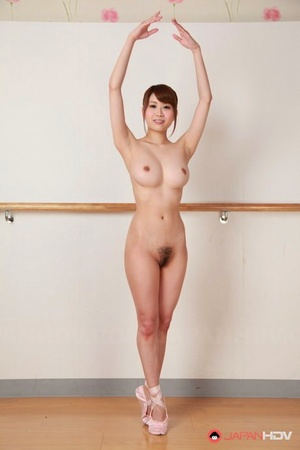 Young Asian dancer Ririka Suzuki opens up nude in studio to bare clean-shaven muff