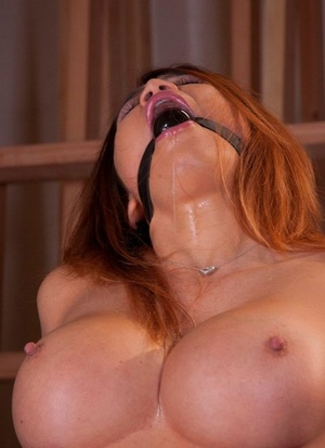 Huge-chested Asian chick Mia Lelani is machine fucked while ballgagged and restrained