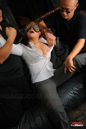 Stunning Japanese slave in collar & leash blindfolded & caged in D/s play