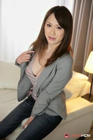 Japanese solo model Yui Takashiro cracks a smile while posing non bare