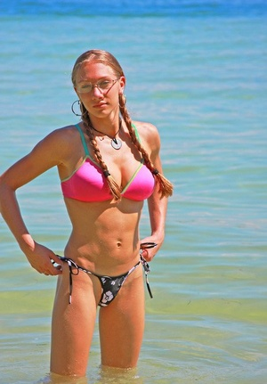 Busty blonde stunner Victoria Nelson swimming topless in the sea