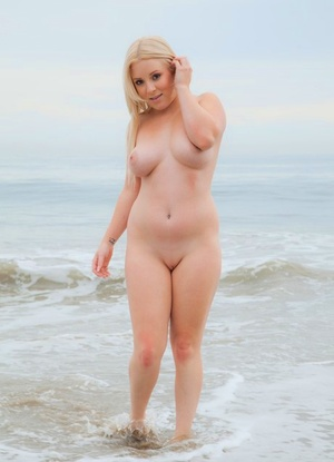 Sexy plump Marilyn removes her bikini to go for a skinny dip in the ocean