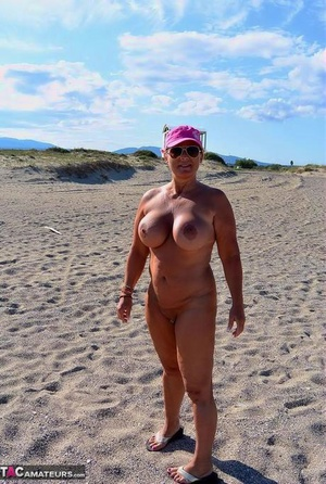Mature fatty Chrissy walks by the sea with her plump big hooters bared