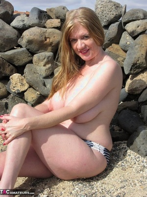Inexperienced plumper Lilymay frees her huge tits and clean-shaved pussy from bikini