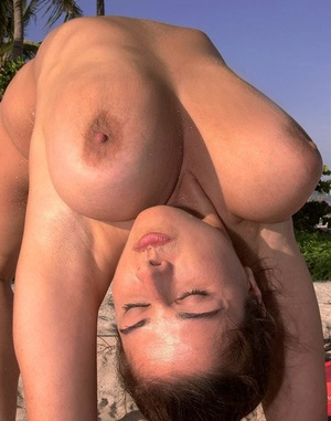 Super busty Chloe Vevrier letting her hefty big tits drape loose at the beach