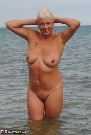 Mature granny Dimonty skinny dipping at the beach with big saggy tits hanging