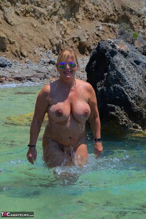 Slutty mature naturist with large tits Chrissy shows her hot kinks at the beach