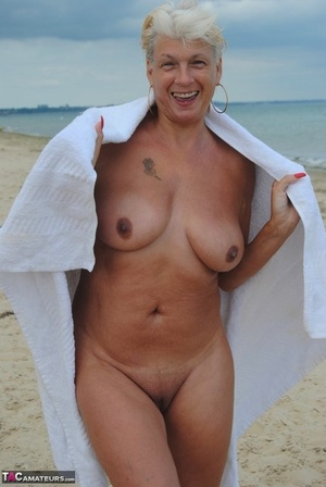 Mature British woman Denise Davies likes flashing her saggy orbs in public