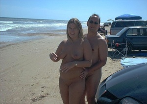Glasses wearing amateur BBW gets gangbanged on a bare beach
