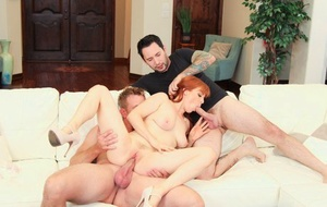 Horny redhead Penny Pax gets dual fucked by her male paramours