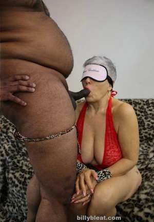 Handcuffed and blindfolded granny sucks off her first ebony cock