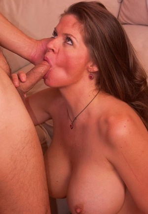 Big titted cougar June Summers concludes fucking her toy boy with a titjob