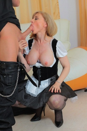 Mature pornstar Nina Hartley goes pussy to mouth in a maid's uniform