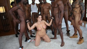 Busty white slut gets on her knees for jizz after interracial gangbang