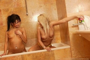 Teen lesbians toy each others g-spot while spending quality time in a bathtub