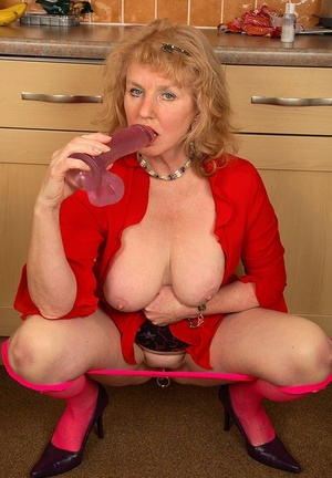 Older UK lady Pearl sucks her dildo after it was up her honeypot