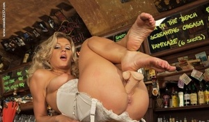 Platinum-blonde chick removes vintage lingerie and nylons to pose nude inside a bar