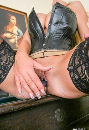 Beautiful blonde Ines Cudna toys her twat in leather corset and sexy pantyhose