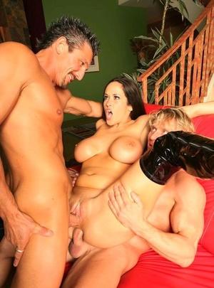 Busty chick Carmella Bing does a xxx Double penetration wearing black stripper shoes