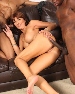 Redhead cougar Desi Foxx fucks 2 black guys that can't pay her the rent money