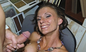 Horny female welcomes the sexual advances of her guy in her home office