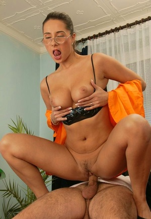 Nerdy businesswoman seduces and fucks a junior employee of hers