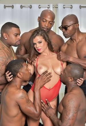 Beautiful brunette model gets Double penetration while black men gangbang her