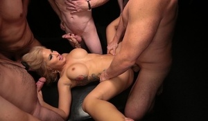 Busty white chick licks up cum while getting gangbanged by white men