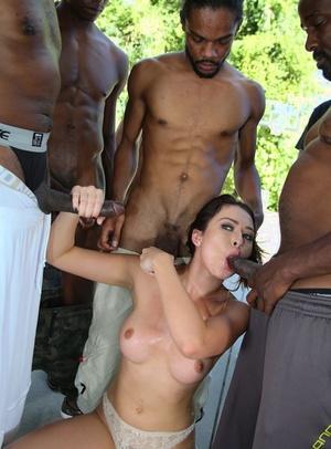 White slut Melissa Moore sucks off a group of big black cocks
