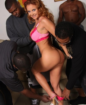 Horny hot redhead Janet Mason is dripping cum after this interracial group sex