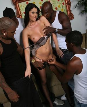 Sexy brunette Eva Karera realizes her interracial gangbang dreams in stockings