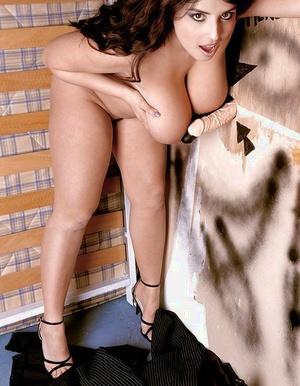 Big brunette superstar Kerry Marie loosing big tits at local gloryhole