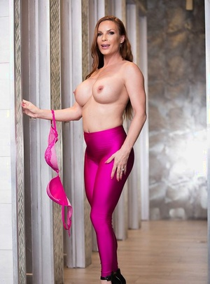 Redhead housewife Diamond Foxxx baring big tits in yoga trousers for honey pics