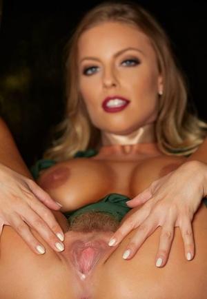Beautiful platinum-blonde Britney Amber crosses her nude legs before spreading her twat