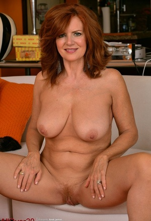 Mature redhead Andi James showcases her pussy in the bare