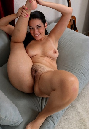 Smiley brunette Nyla Parker undressing slowly to suck on her killer toes bare