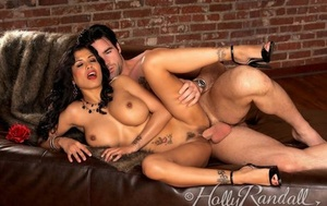 Warm dark-haired Mariah Milano uncovers her nice tits while seducing her man