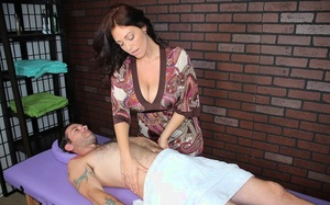 Huge-chested MILF Charlee Chase jerks off a cock during a massage