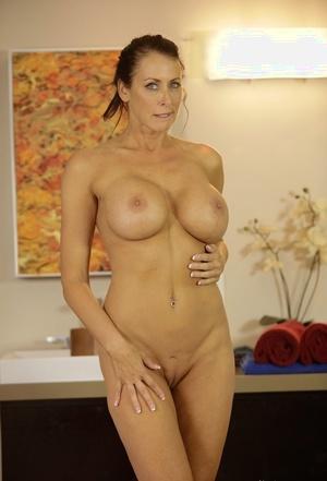 Busty American chick Reagan Foxx strips off her bikini to showcase her big tits