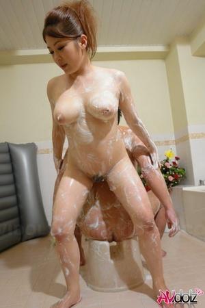 Japanese masseuse Mirai Haneda pleasures a man with a soapy rubdown
