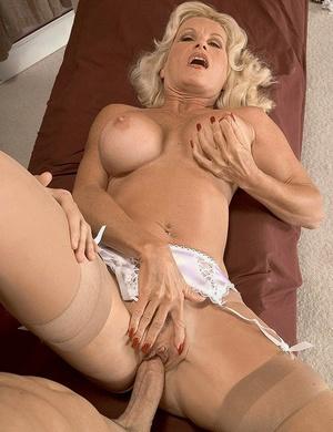 Older light-haired masseur Julia Butt sucks and fucks a client's big cock