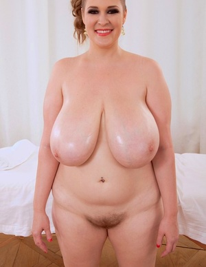 Canadian BBW Smiley Emma unleashes her knockers before masturbating