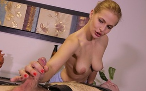 Aggressive masseuse Sloan Harper restrains a man and teases his dick during massage