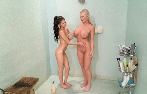 Busty blonde and her teenage stepdaughter give each other a lesbian massage