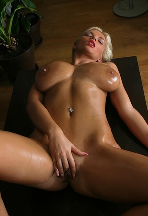 Blonde babe Ines Cudna covers her huge breasts with grease in solo action