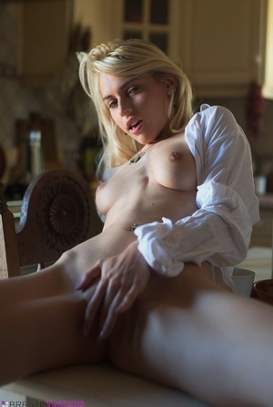 Hot blonde Chloe Toy strikes great solo poses in a white blouse